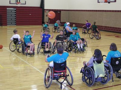 Playing basketball at junior wheelchair camp
