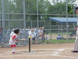 Tee ball player comes up to bat